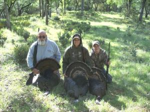 Bryan McCoard (r) after a turkey hunt with his grandfather Ron Neilsen Sr. (l) and his mother Christy McCoard.