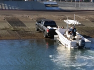 a small fishing boat is launched from the crumbling concrete ramp at San Diego's Shelter Island