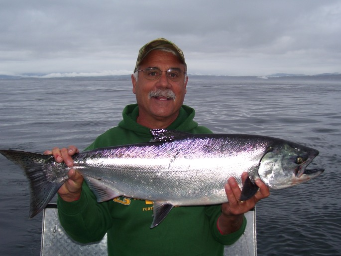 Angler holding north coast salmon